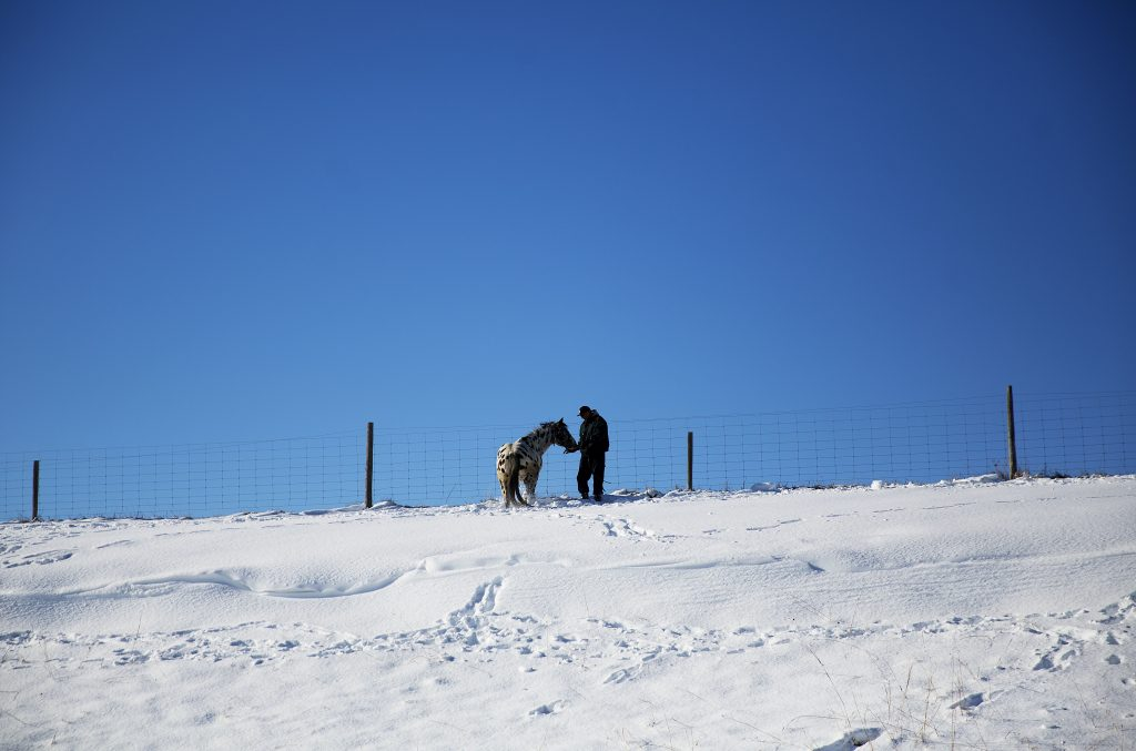 A man (R) and a horse walk along a ridge near the Oceti Sakowin camp where people have gathered to protest the Dakota Access oil pipeline in Cannon Ball, N.D., Sunday, Dec. 4, 2016. U.S. Army Corps of Engineers spokeswoman Moria Kelley said in a news release Sunday that the administration will not allow the four-state, $3.8 billion pipeline to be built under Lake Oahe, a Missouri River reservoir where construction had been on hold. (AP Photo/David Goldman)