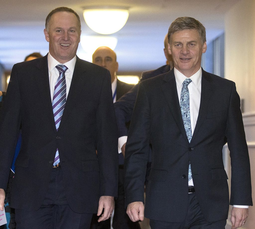 FILE - In this May 26, 2016 photo, Finance Minister Bill English, right, walks with New Zealand Prime Minister John Key to the House to deliver his Budget 2016 speech, in Wellington, New Zealand. English is set to become New Zealand's next prime minister following the shock resignation of John Key. (Mark Mitchell/New Zealand Herald via AP, File)