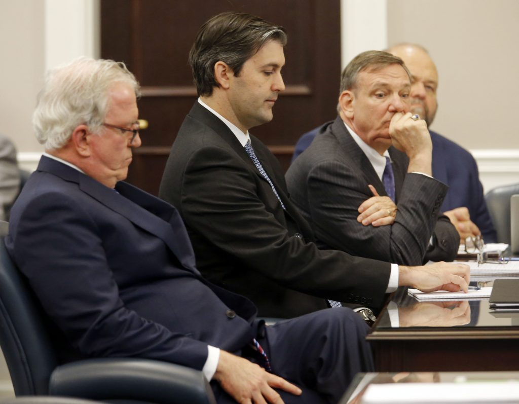 Defense attorneys Andy Savage (L) Don McCune, and Miller Shealy (R) sit around former North Charleston police officer Michael Slager at the Charleston County court in Charleston, S.C., on Monday. (Grace Beahm/Post and Courier via AP, Pool)