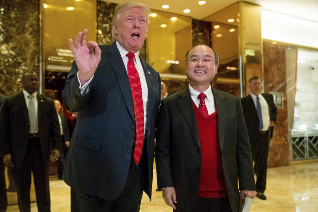 President-elect Donald Trump and SoftBank CEO Masayoshi Son speak to the media at Trump Tower in New York on Tuesday. (AP Photo/Andrew Harnik)