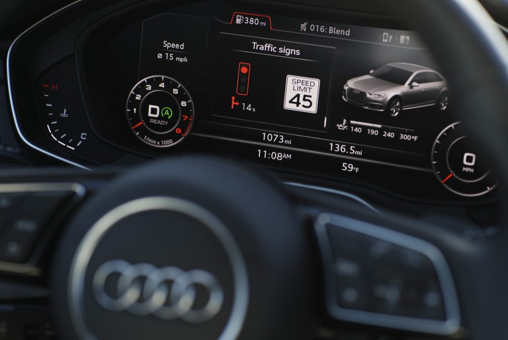 """The dashboard of an Audi A4 is seen during a demonstration of Audi's vehicle-to-infrastructure technology Tuesday, Dec. 6, 2016, in Las Vegas. The technology allows vehicles to """"read"""" red lights ahead and tell the driver how long it'll be before the signal turns green. For the driver, the system puts a traffic signal icon on the dashboard telling how many seconds the light will remain red. (AP Photo/John Locher)"""