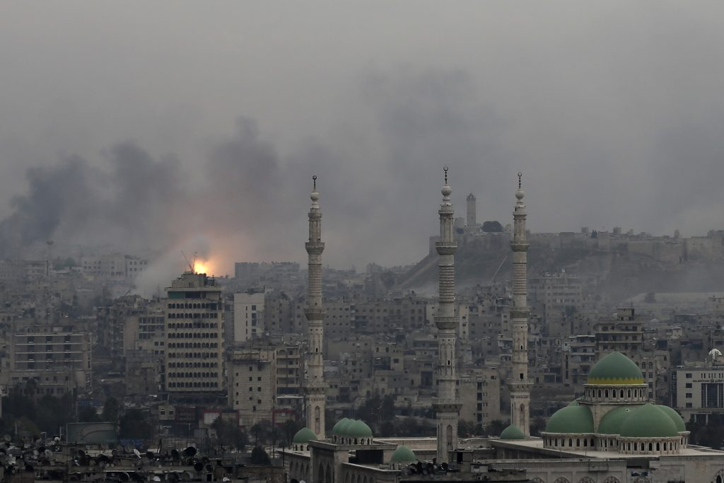 A ball of fire rises following an airstrike on insurgents positions in eastern neighborhoods of Aleppo, Syria. (AP Photo/Hassan Ammar, File)