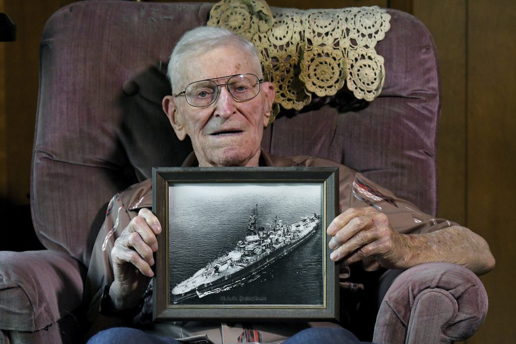 Earl Wanbaugh holding a photo of the U.S.S. Pennsylvania in his Independence, Mo., home, on Monday. (John Sleezer/The Kansas City Star via AP)