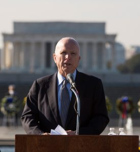 With the Lincoln Memorial in the background, Sen. John McCain, R-Ariz. speaks Wednesday during the Pearl Harbor 75th anniversary commemoration, at the National World War II Memorial in Washington. (AP Photo/Molly Riley)