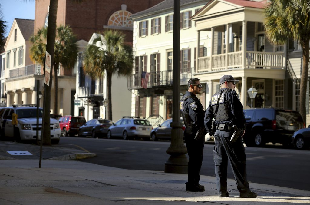 Homeland Security patrol the streets outside the federal courthouse in Charleston,S.C., on Wednesday. (Grace Beahm/The Post And Courier via AP)