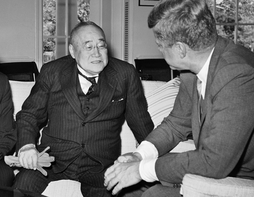FILE - In this May 3, 1962 file photo, U.S. President John F. Kennedy, right, meets with former Japanese Prime Minister Shigeru Yoshida in his White House office in Washington. The news media widely reported this week that Shinzo Abe will be the first Japanese prime minister to visit Pearl Harbor when he goes later this month _ but he might not be. A 1951 article in Japan's largest newspaper says that then-Prime Minister Shigeru Yoshida went to Pearl Harbor during a stopover in Hawaii on the way home from San Francisco, where he had signed a peace treaty with the allied powers and other nations. (AP Photo/William J. Smith, File)