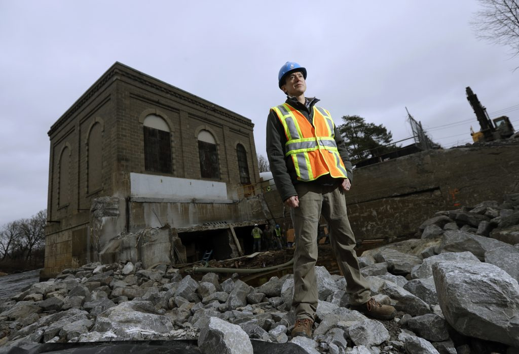 Tony David, water resources program manager for the St. Regis Mohawk Reservation, in front of a decommissioned hydroelectric powerhouse in Hogansburg, N.Y. (AP Photo/Mike Groll)