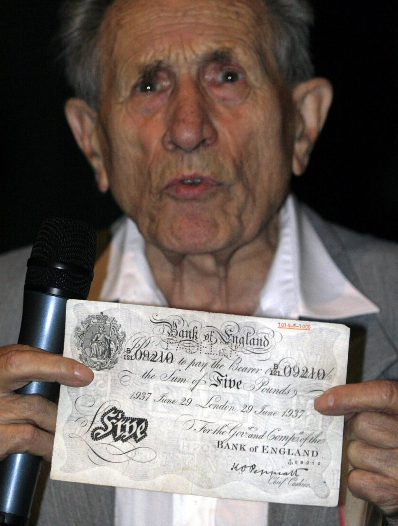 Adolf Burger shows one of the forged banknotes, in 2007. (Roman Vondrous/CTK via AP,file)