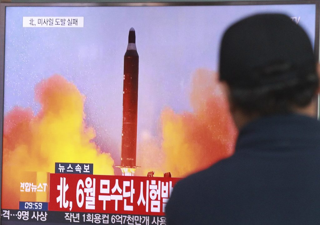 A South Korean news program showing a file image of a missile launch conducted by North Korea. (AP Photo/Ahn Young-joon, File)