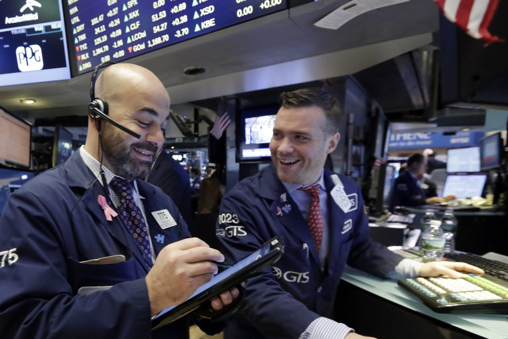 Trader Fred DeMarco, left, and specialist Frank Masiello work on the floor of the New York Stock Exchange on Friday. (AP Photo/Richard Drew)