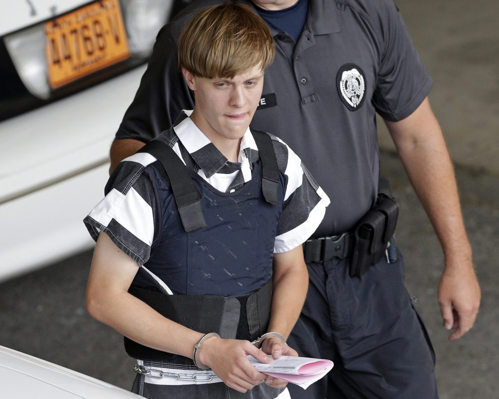 Dylann Roof is escorted from the courthouse upon his arrest in June 2015.  (AP Photo/Chuck Burton, File)