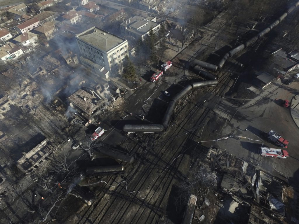 An aerial view showing aerial view emergency services attending the scene of devastation after a tanker-train derailed and a gas tank exploded in the village of Hitrino, northeastern Bulgaria, early Saturday. (Petar Petrov/Sky Pictures Bulgaria via AP)