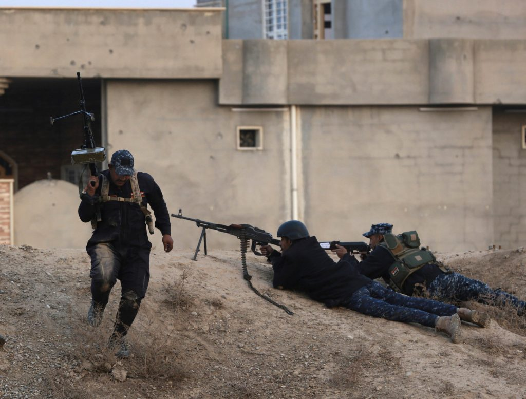 Iraqi federal police forces fight Islamic State militants on the front line, outside Mosul, Iraq, Saturday, Dec. 10, 2016. An Iraqi commander says reinforcements have been sent to eastern Mosul after a major Islamic State counterattack drove troops back last week, further slowing a nearly two-month-old offensive to retake the city. (AP Photo/Hadi Mizban)