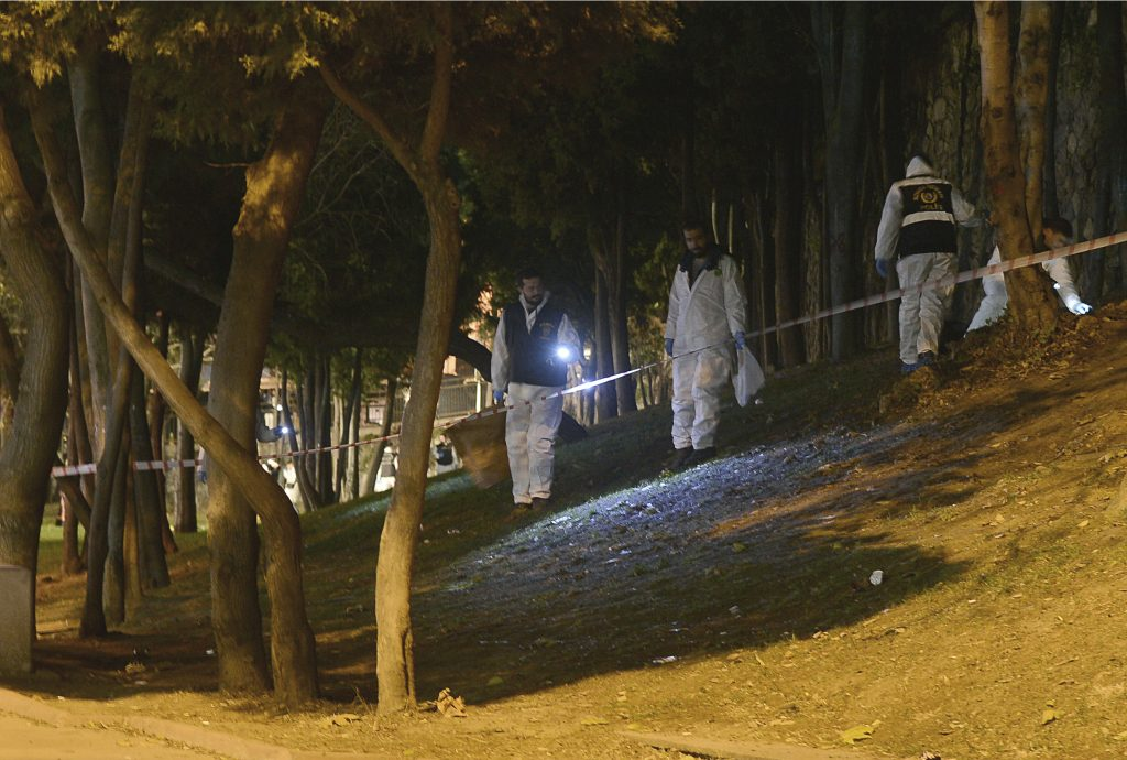 Forensic officials work at the scene of explosions near the Besiktas football club stadium after attacks in Istanbul, late Saturday, Dec. 10, 2016. Two explosions struck Saturday night outside a major soccer stadium in Istanbul after fans had gone home, an attack that wounded about 20 police officers, Turkish authorities said. Turkish authorities have banned distribution of images relating to the Istanbul explosions within Turkey.(Ismail Coskun, IHA via AP)