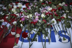 Flowers are laid on a police car outside the Vodafone Arena in Istanbul, Sunday. (AP Photo/Emrah Gurel)