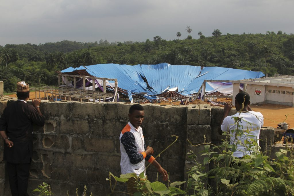 Tthe site of a collapsed church in Uyo, Nigeria, on Sunday. (AP Photo)