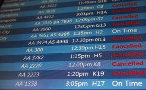 A screen displays flight status information at O'Hare International Airport on Sunday. (AP Photo/Nam Y. Huh)