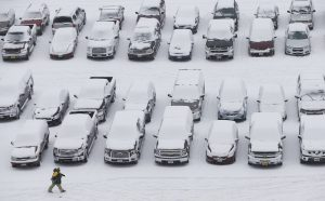 A man walks through a stadium parking lot in Green Bay, Wis., on Sunday. (AP Photo/Mike Roemer)