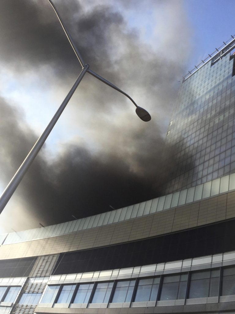 Smoke rises from a building under construction at the NYU Langone Medical Center on the east side of Manhattan on Wednesday. (AP Photo/Andres Kudacki)