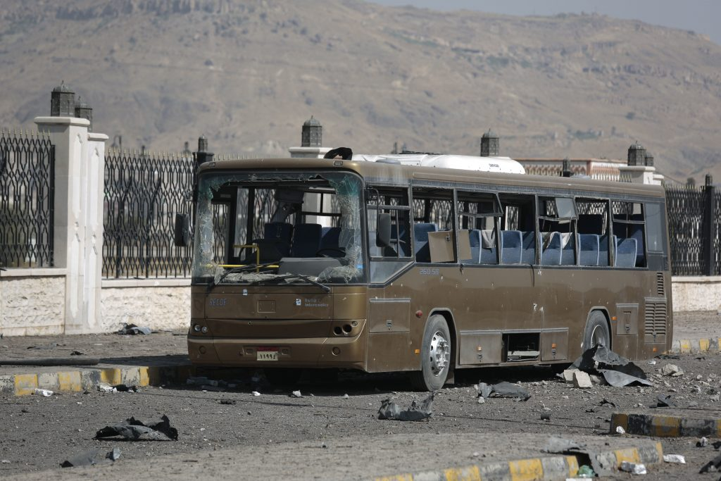 A damaged military bus remains at the site of a Saudi-led air strike, near the al-Saleh mosque, in Sanaa, Yemen, Wednesday, Dec. 14, 2016. (AP Photo/Hani Mohammed)