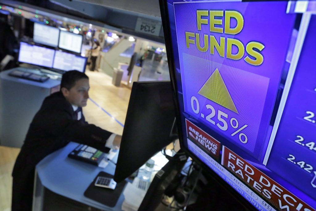 Specialist Jeffrey Berger works at his post on the floor of the New York Stock Exchange as the interest-rate decision of the Federal Reserve is announced Wednesday afternoon. (AP Photo/Richard Drew)