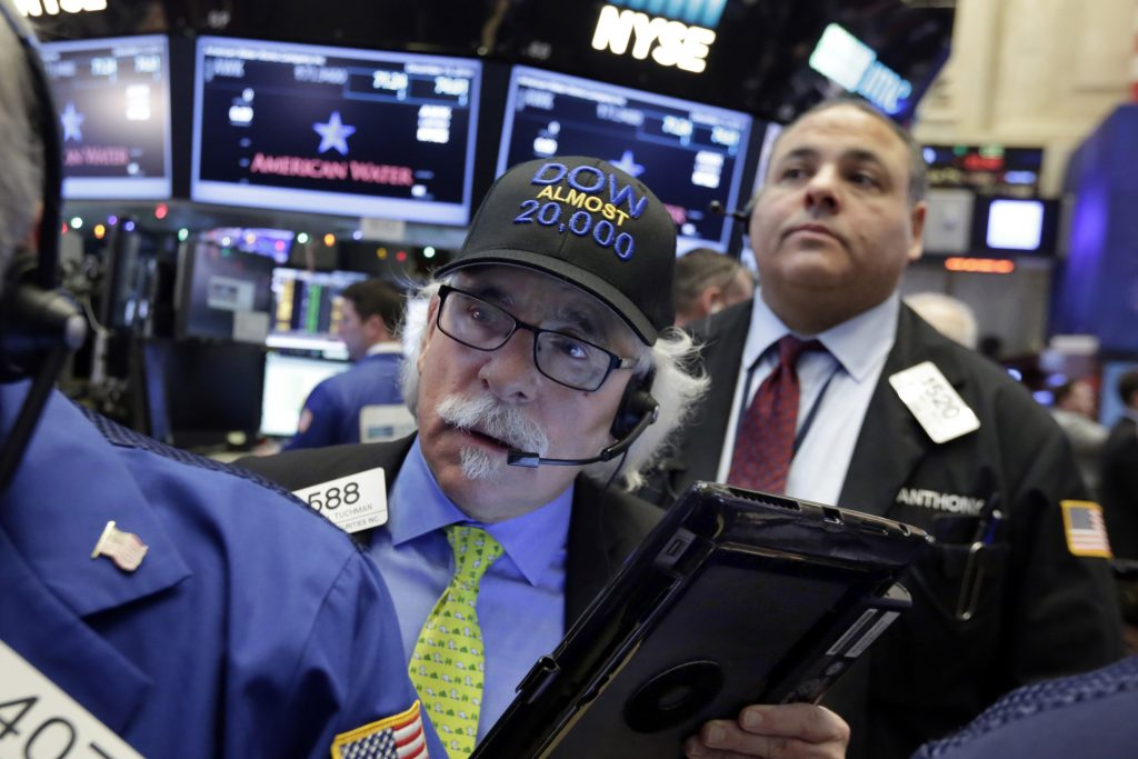 "Trader Peter Tuchman wears his ""Dow Almost 20,000"" cap as he works on the floor of the New York Stock Exchange, Thursday, Dec. 15, 2016. Stocks are opening moderately higher on Wall Street and the dollar is making more gains against other currencies a day after the Federal Reserve raised its benchmark interest rate. (AP Photo/Richard Drew)"