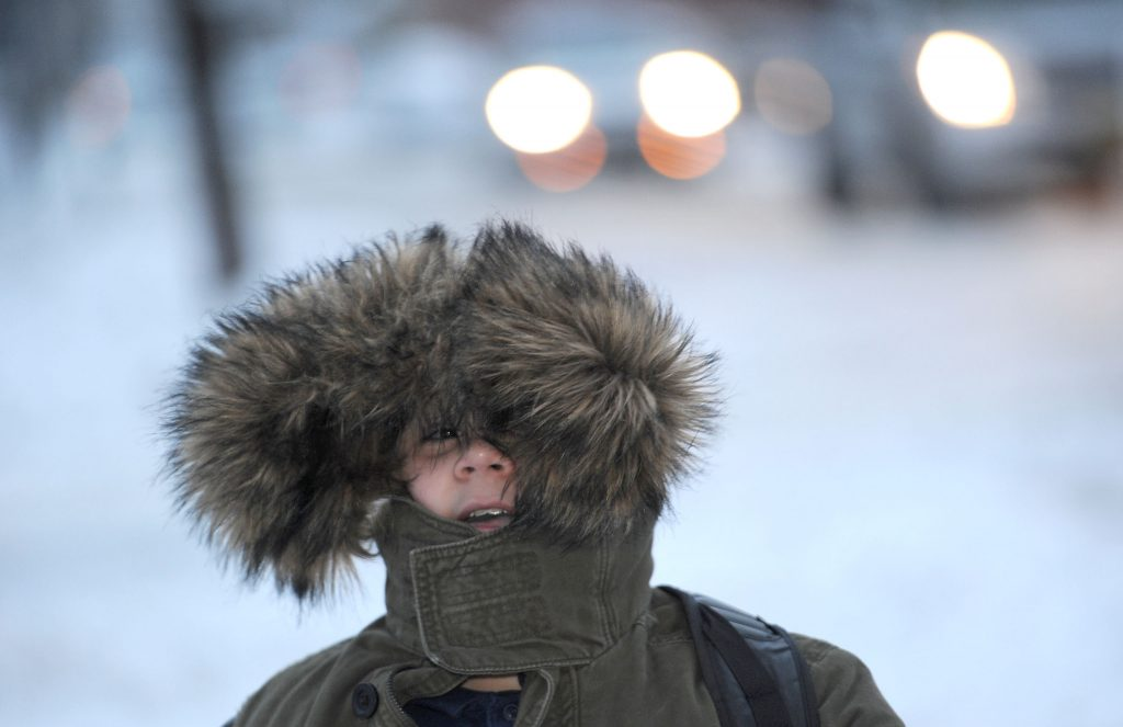Kasim Kantarevic, 12, keeps his hood up as he walks to school on Thursday in Erie, Pa. (Christopher Millette/Erie Times-News via AP)