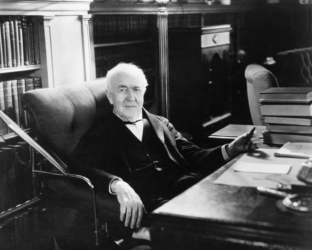 Thomas Alva Edison sitting at his desk in the family living room at the Glenmont mansion in Llewellyn Park, West Orange, N.J. (AP Photo)