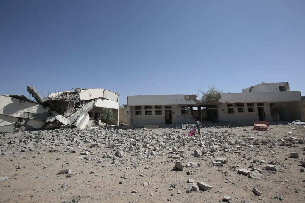 A boy walks amid the rubble of a damaged school by Saudi-led airstrikes in Saada province, northwest of Sanaa, Yemen, in October. (AP Photo/Hani Mohammed)