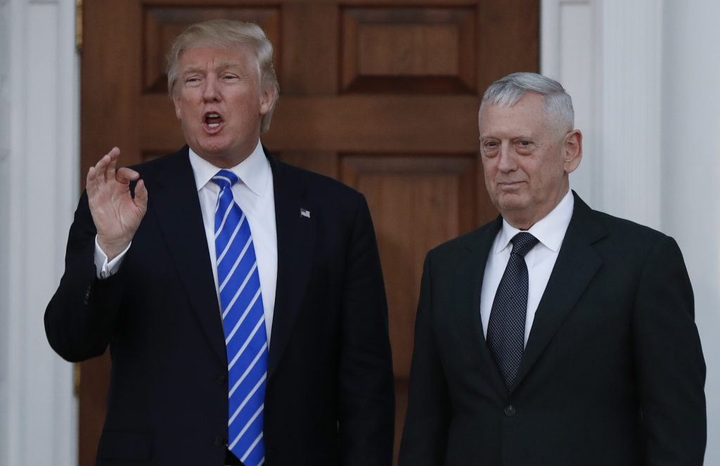 President-elect Donald Trump talks to the media as he stands with retired Marine Corps Gen. James Mattis at the Trump National Golf Club Bedminster clubhouse in Bedminster, N.J., Saturday, Nov. 19, 2016. (AP Photo/Carolyn Kaster)