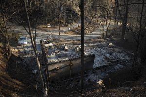 The charred foundation is all remains of a home on the northern outskirts of Gatlinburg, Tenn., on Thursday. (Andrew Nelles/The Tennessean via AP)