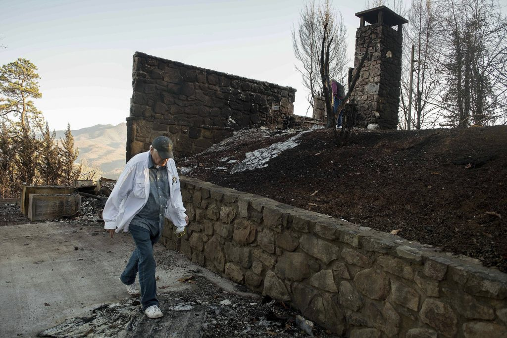 Richard T. Ramsey looks over the remains of the Gatlinburg, Tenn., house that he had lived in for 41 years, on Thursday. (Andrew Nelles/The Tennessean via AP)