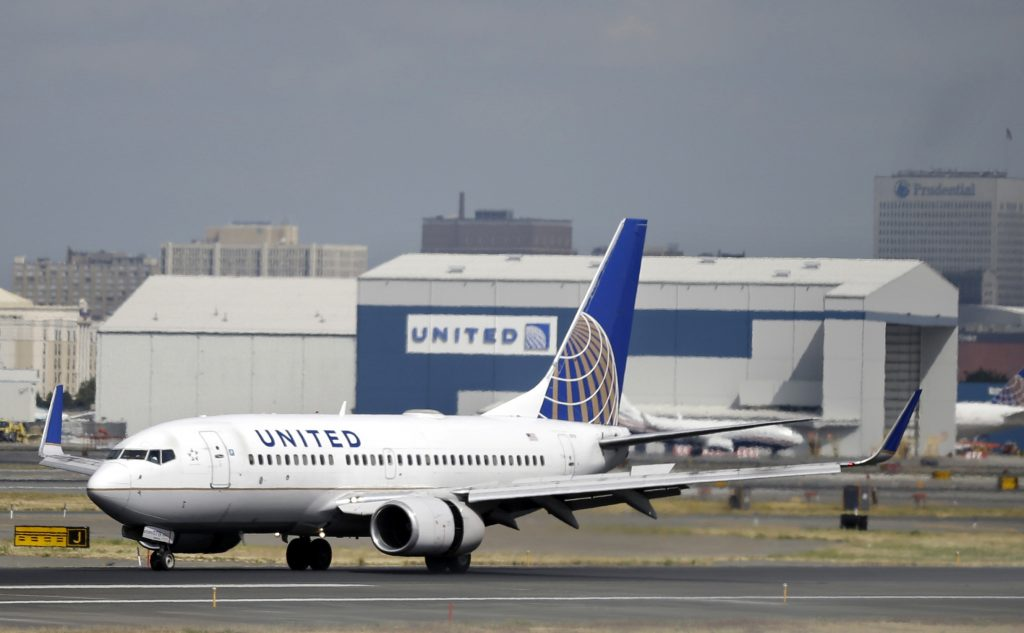 FILE - A United Airlines passenger plane lands at Newark Liberty International Airport in Newark, N.J. (AP Photo/Mel Evans, File)