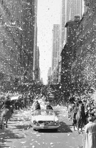 Astronaut John Glenn's motorcade moves up lower Broadway in New York through a cloud of ticker tape on March 1, 1962.  (AP Photo)