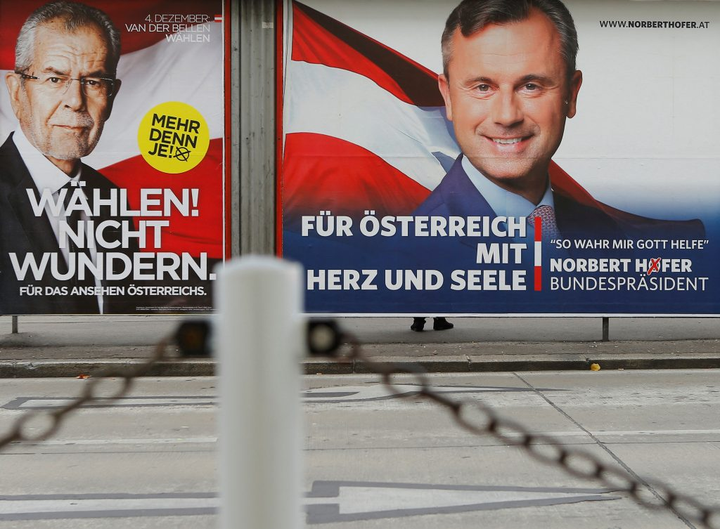 "Presidential election campaign posters of Alexander Van der Bellen, who is supported by the Greens, reading ""Vote! Don't be surprised."" and of Norbert Hofer of the FPOe, reading ""For Austria with heart and soul"", are seen in Vienna, Austria, November 24, 2016. REUTERS/Heinz-Peter Bader/File Photo"