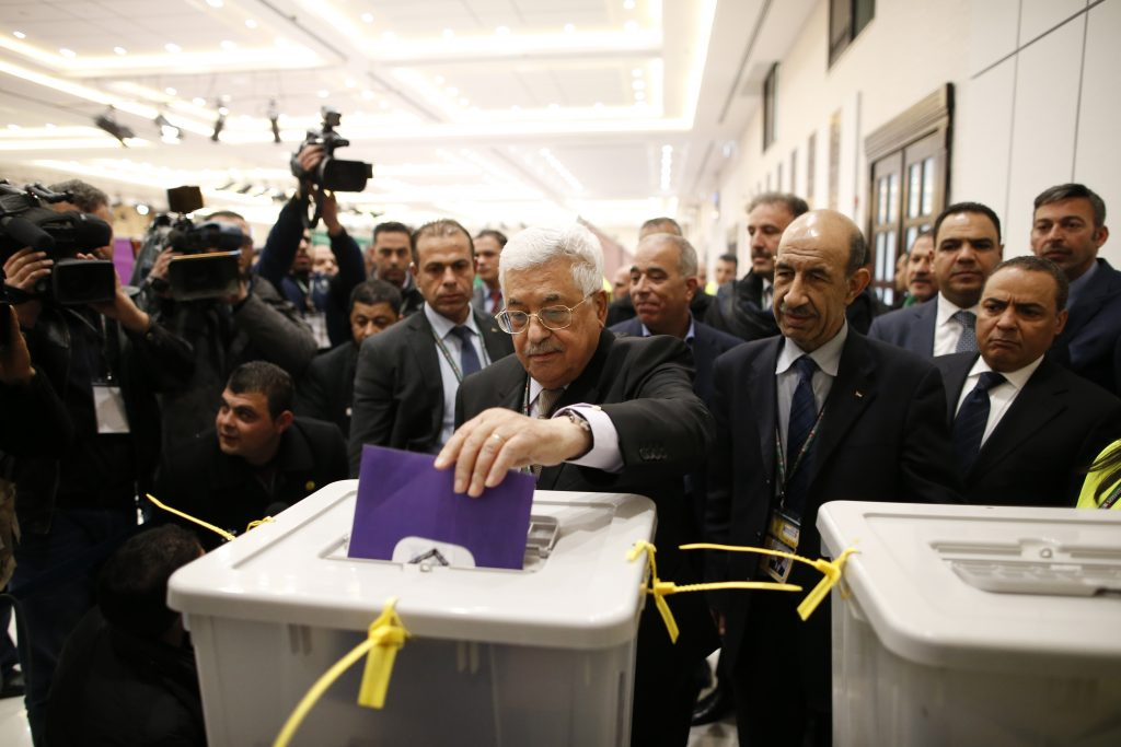 PalestinianAuthority President Mahmud Abbas casts his vote at the Fatah conference in Ramallah. (Ahmad Gharabli/Pool photo via AP)