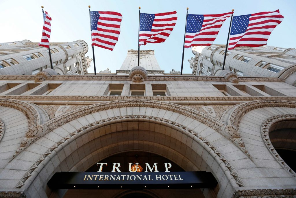 Flags fly above the entrance to the new Trump International Hotel on its opening day in Washington, DC, U.S. September 12, 2016. REUTERS/Kevin Lamarque/File Photo