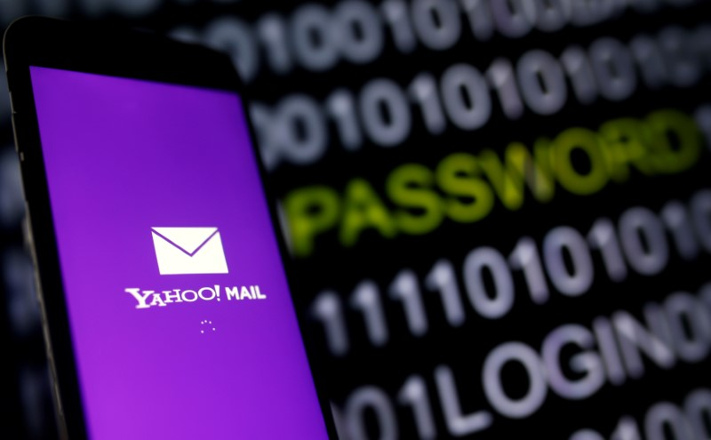 Yahoo Mail logo is displayed on a smartphone's screen in front of code in this illustration picture, October 6, 2016. REUTERS/Dado Ruvic/Illustration/File Photo