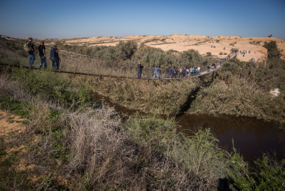 Israelis enjoy the Hanukkah holiday, as they cross the hanging bridge at Bsor River, in Tze'elim, southern Israel, on December 9, 2015. Photo by Hadas Parush/Flash90. *** Local Caption *** ??? ????? ??? ????? ??? ???? ???? ??? ???? ????? ??????? ?? ????? ???? ?????