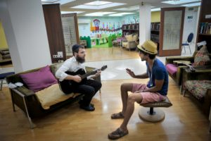 A Jewish traveller plays music in the Beth Chabad house in Bangkok, Thailand. January 14, 2016. Photo by Serge Attal/FLASH90 *** Local Caption *** ??''? ?????? ?????? ?????? ??????