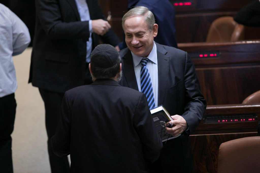 Israeli Prime Minister Binyamin Netanyahu seen during a vote on the Settlements Law, a bill that seeks to legitimize outposts in Yehudah and Shomron, in the Knesset on Monday, December 5. (Yonatan Sindel/Flash90)