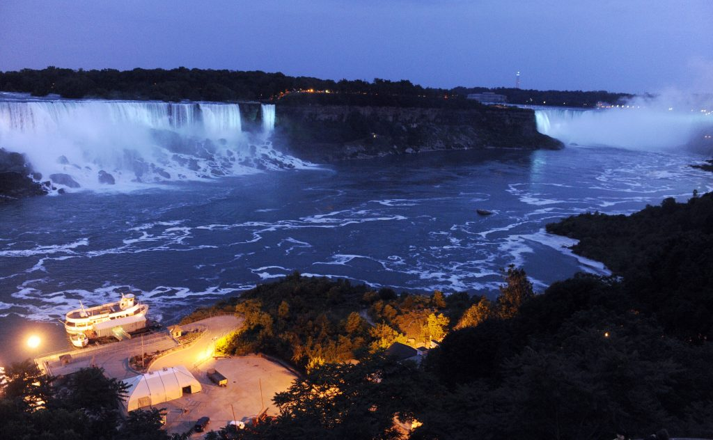 The Canadian side of the American Falls and Horseshoe Falls are illuminated in blue in 2013 to celebrate the birth of the Duke and Duchess of Cambridge's son. (AP Photo/Gary Wiepert, File)