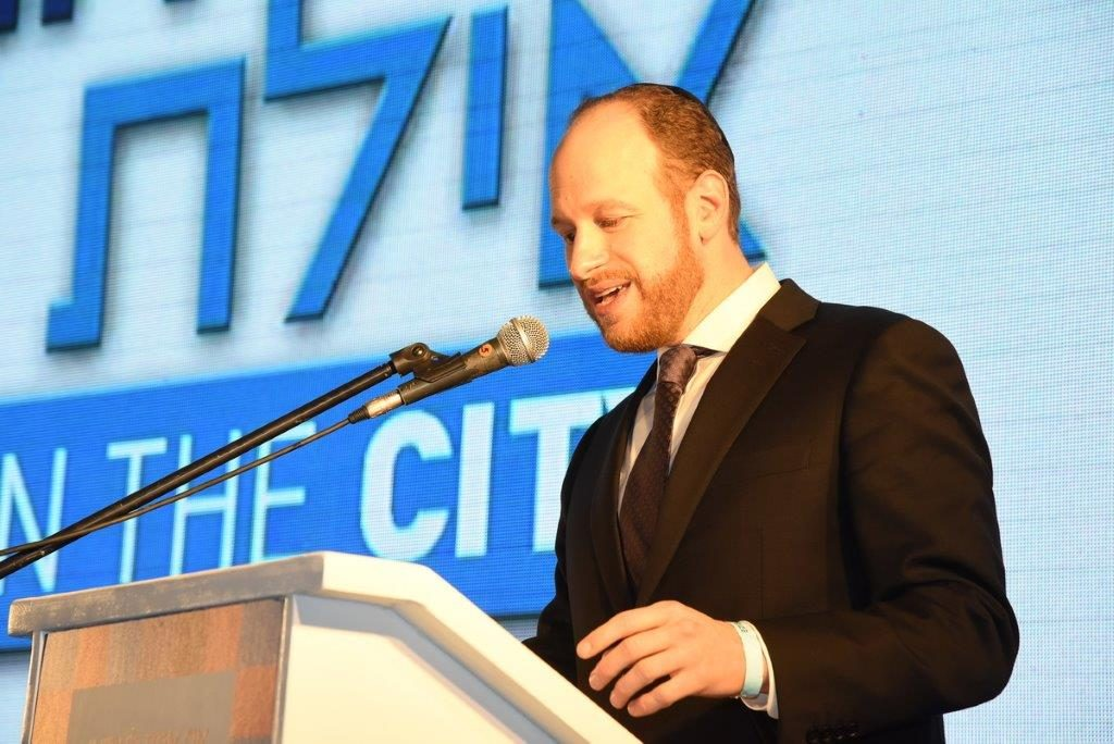 Councilman David Greenfield delivering a keynote address at the Nadlan conference in Israel last week.