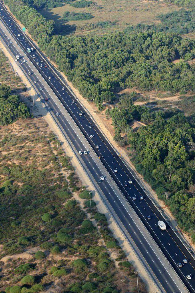An aerial view of traffic on Highway No. 2. Waze sends drivers to Herzliya, along the route, to avoid bottlenecks, and the local residents don't like it. (Moshe Shai/Flash90)