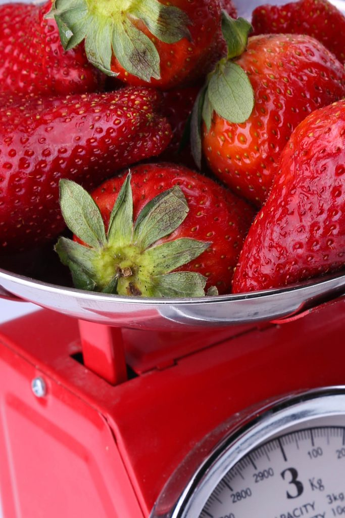 Weighing strawberries. (Gitty Golds)