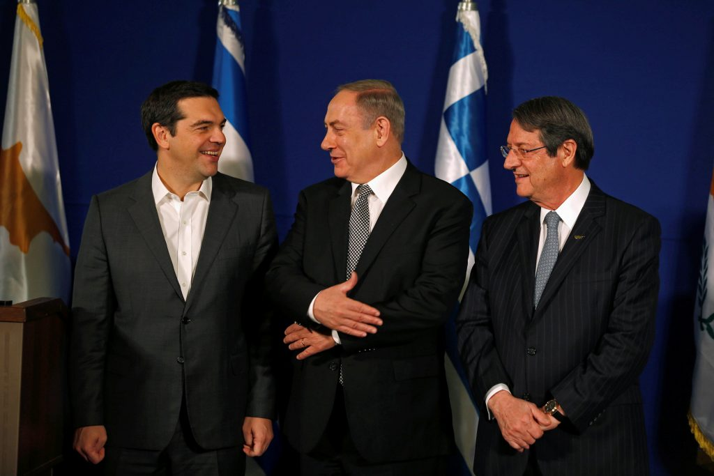 Cypriot President Nicos Anastasiades, Israeli Prime Minister Benjamin Netanyahu and Greek Prime Minister Alexis Tsipras shake hands during their meeting in Jerusalem December 8, 2016. REUTERS/Amir Cohen