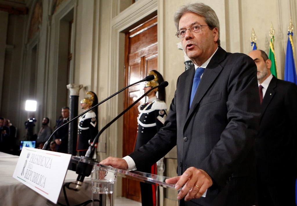 Italy's Foreign Minister Paolo Gentiloni talks to reporters after receiving a mandate to try to form the country's new government, at the Quirinal Palace in Rome, Italy December 11, 2016. REUTERS/Remo Casilli