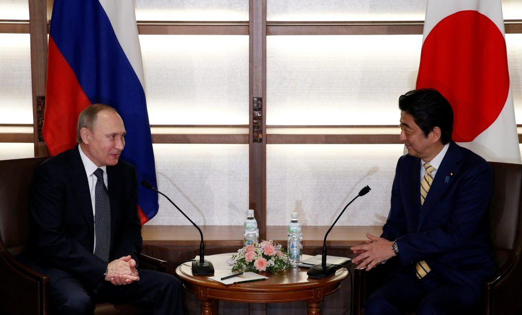 Russia's President Vladimir Putin (L) talks with Japan's Prime Minister Shinzo Abe at the start of their summit meeting in Nagato, Yamaguchi prefecture, Japan, December 15, 2016. REUTERS/Toru Hanai