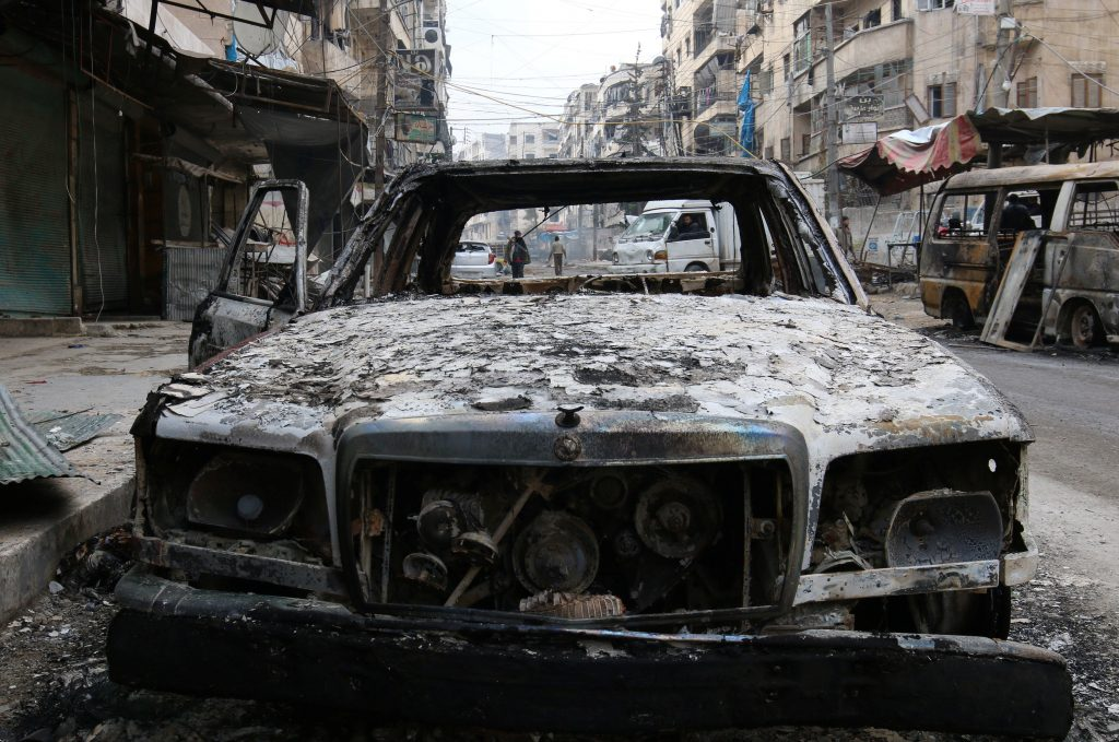 A burnt car is pictured in a rebel-held sector of eastern Aleppo, Syria December 17, 2016. REUTERS/Abdalrhman Ismail TPX IMAGES OF THE DAY