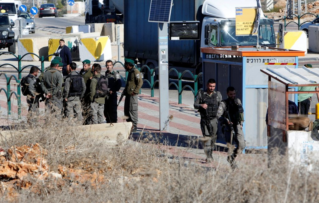 Israeli forces gather near the scene where Israeli paramilitary police officers shot and killed a Palestinian who Israeli police said ran toward them brandishing a knife, near the Israeli Tapouh junction south of the West Bank city of Nablus December 8, 2016. REUTERS/Abed Omar Qusini